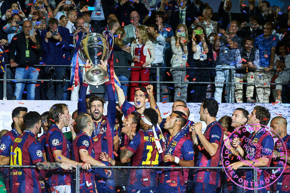 Gerard Pique of FC Barcelona holds trophy while victory ceremony during the 2014/15 UEFA Champions League Final between Juventus and FC Barcelona at Olympiastadion on June 6, 2015 in Berlin, Germany.<br /> Germany, Berlin, June 6, 2015<br /> <br /> Picture also available in RAW (NEF) or TIFF format on special request.<br /> <br /> For editorial use only. Any commercial or promotional use requires permission.<br /> <br /> Adam Nurkiewicz declares that he has no rights to the image of people at the photographs of his authorship.<br /> <br /> Mandatory credit:<br /> Photo by &copy; Adam Nurkiewicz / Mediasport