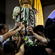 Citizens of Manila pray under the statue of Jesus for the end of violence in the streets.