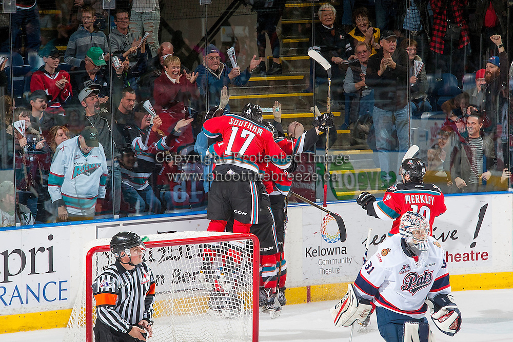KELOWNA, CANADA - NOVEMBER 26: Rodney Southam #17 of the Kelowna Rockets jumps against the glass after the game winning OT goal against the Regina Pats on November 26, 2016 at Prospera Place in Kelowna, British Columbia, Canada.  (Photo by Marissa Baecker/Shoot the Breeze)  *** Local Caption ***