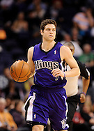 Dec. 17, 2012; Phoenix, AZ, USA; Sacramento Kings guard Jimmer Fredette (7) dribbles the ball up the court during the game against the Phoenix Suns in the first half at US Airways Center. Mandatory Credit: Jennifer Stewart-USA TODAY Sports.
