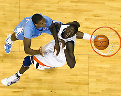 North Carolina forward Deon Thompson (21) shoots over Virginia center Assane Sene (5). The the #5 ranked North Carolina Tar Heels defeated the Virginia Cavaliers 83-61 in NCAA Basketball at the John Paul Jones Arena on the Grounds of the University of Virginia in Charlottesville, VA on January 15, 2009.