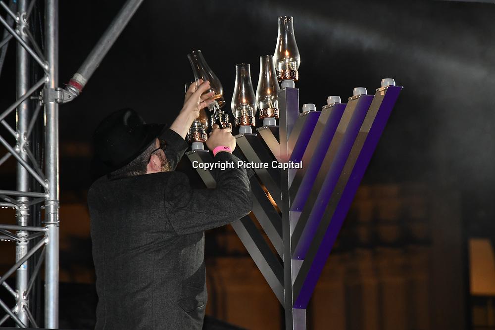 Sudak Rabbi joins the ceremony to light a sacred Menorah to celebrate Chanukah (Hanukkah), the eight-day Jewish Festival in Trafalgar Square, 5th December 2018, London, UK.
