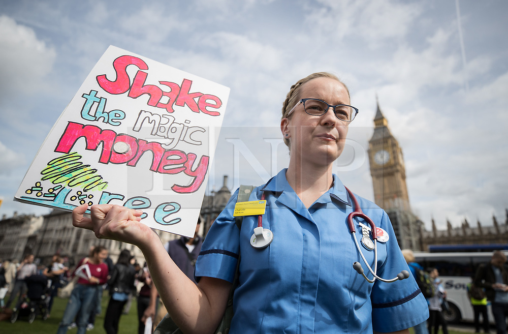 © Licensed to London News Pictures. 06/09/2017. London, UK. A nurse holds a placard referring to a statement by Prime Minister Theresa May's during a demonstration in Parliament Square. The Royal College of Nursing is campaigning against the Government's one per cent cap on public sector pay. Photo credit: Peter Macdiarmid/LNP