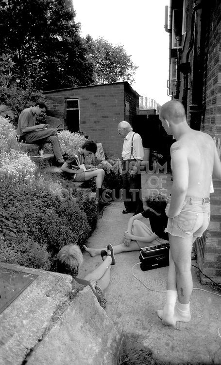 Gavin with family in garden. High Wycombe, UK. 1980s.