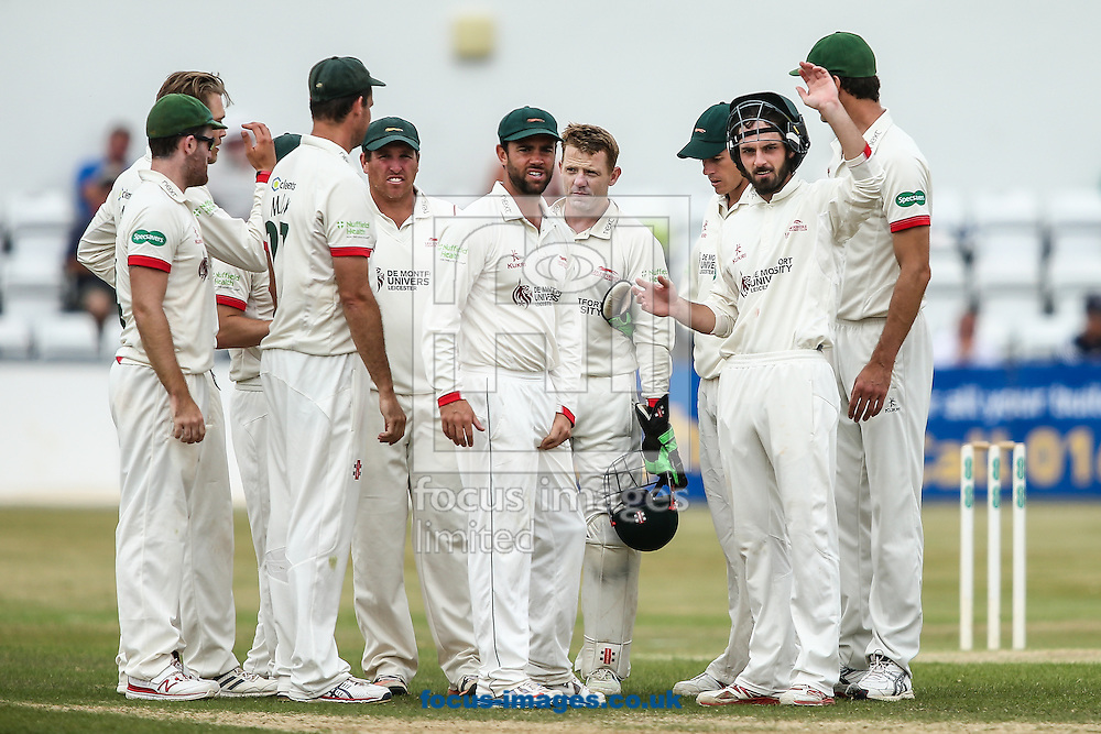 Leicestershire players celebrate taking the wicket of Alex Wakely of Northamptonshire CCC (not shown) during the Specsavers County C'ship Div Two match at the County Ground, Northampton<br /> Picture by Andy Kearns/Focus Images Ltd 0781 864 4264<br /> 14/08/2016