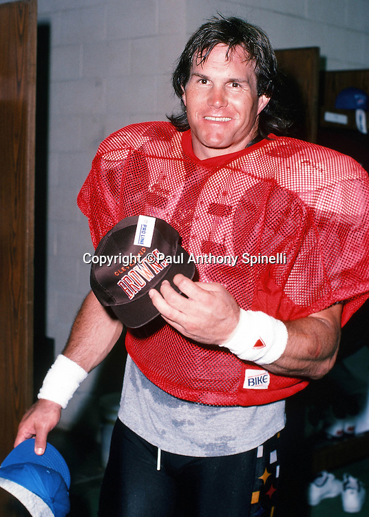 Cleveland Browns linebacker Clay Matthews (74) holds up a Browns cap in the locker room after practice the week of the 1990 NFL Pro Bowl between the National Football Conference and the American Football Conference on Jan. 30, 1990 in Honolulu. The NFC won the game 27-21. (©Paul Anthony Spinelli)