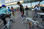 "A group of Beijingite cyclists get together for their weekly ""small tires"" group ride near Olympic Stadium."