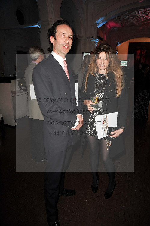 Viscount Cranley and JEMIMA KHAN at an exhibition and charity auction entitled Shoebox Art in aid of Kids Company held at the Haunch of Venison, Burlington Gardens, London on 18th March 2010.