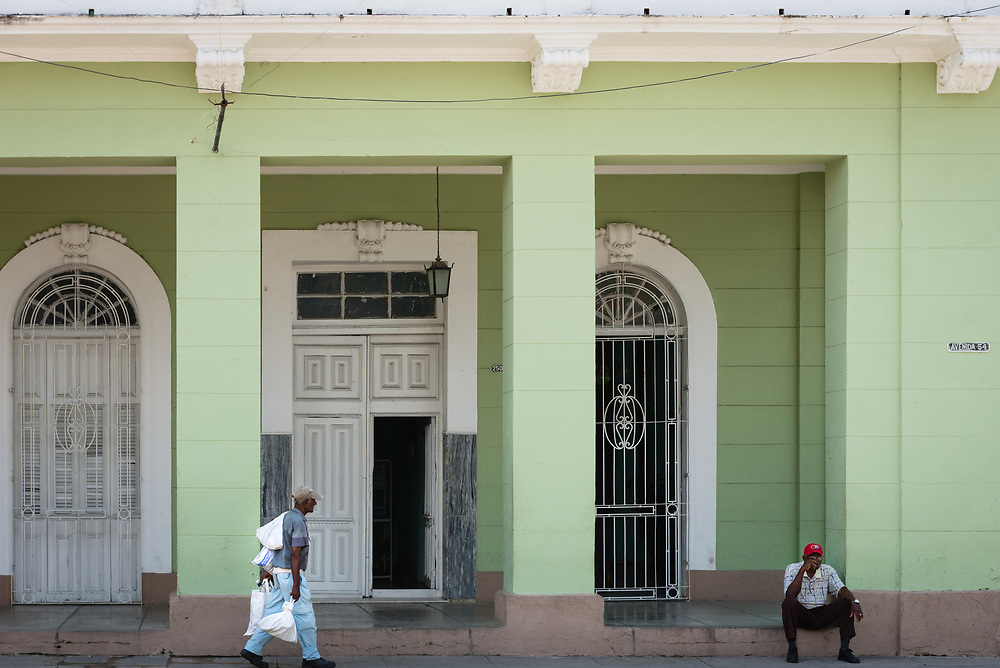 Man sitting on a step in Cienfuegos