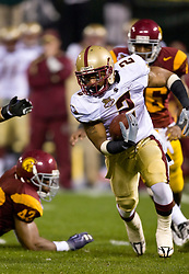 Dec 26, 2009; San Francisco, CA, USA;  Boston College Eagles running back Montel Harris (2) rushes past Southern California Trojans defensive end Devon Kennard (42) during the first quarter of the 2009 Emerald Bowl at AT&T Park.  USC defeated BC 24-13.