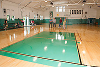 Councilor Armand Bolduc, Director Kevin Dunleavy, Councilor Bob Hamel and Asst Director Amy Lovisek after the ribbon cutting for the new gym floor at Laconia Community Center Monday morning.  (Karen Bobotas/for the Laconia Daily Sun)