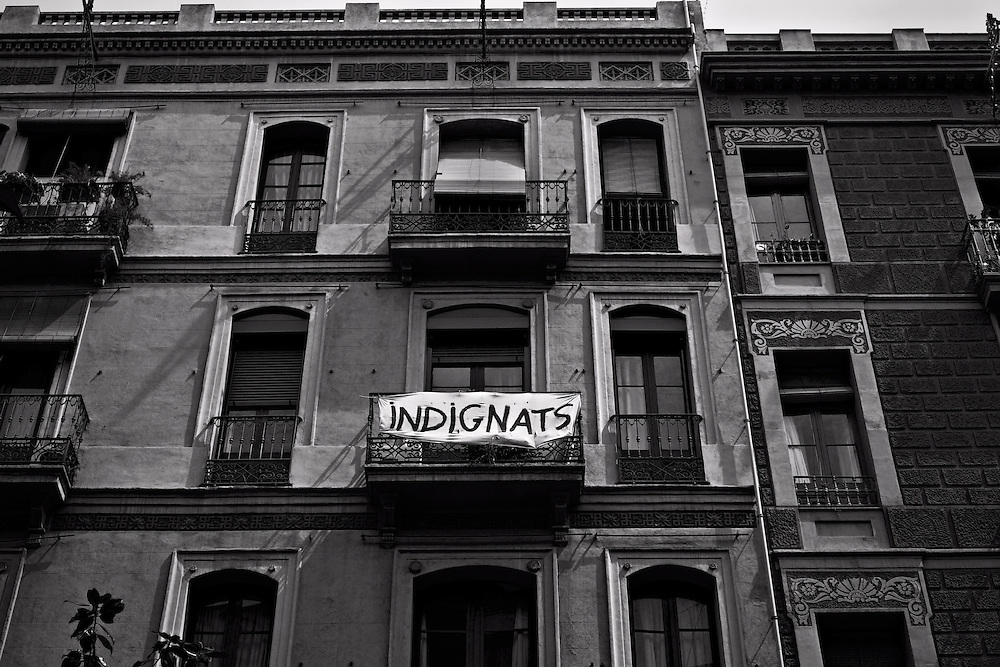 Indignats protest sign draped over balcony in Barcelona, Spain