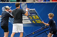 Picture by Ste Jones/Focus Images Ltd.  07706 592282.23/06/12.Greg Rusedski (GBR) helps replace the scoreboard during high winds during the +medicash Liverpool International 2012 tennis at Calderstones Park, Liverpool.