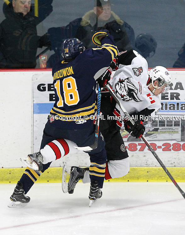 GEORGETOWN, ON  - MAR 2,  2017: Ontario Junior Hockey League, playoff game between the Georgetown Raiders and the Buffalo Jr Sabres. Cameron Radziwon #18 of the Buffalo Jr. Sabres makes the hit on Colin Rigney #10 of the Georgetown Raiders during the first period.<br /> (Photo by Tim Bates / OJHL Images)