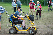 All terain disability scooter - The 2016 Glastonbury Festival, Worthy Farm, Glastonbury.