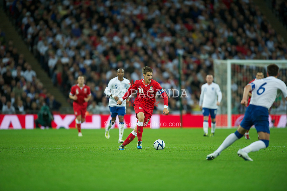 LONDON, ENGLAND - Tuesday, September 6, 2011: Wales' captain Aaron Ramsey in action against England during the UEFA Euro 2012 Qualifying Group G match at Wembley Stadium. (Pic by David Rawcliffe/Propaganda)