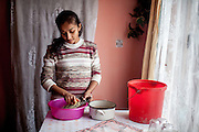 Jana, 23 year old wife of Emil (20) and mother of a son is preparing lunch for her family in their new built house in Rankovce. In Slovakia are living approximately more then 400.000 Roma - what is about 7,45% of the whole Slovak population (according to the New Atlas of Roma Communities published 09/2013) - about one third of them is living in unsatisfactory conditions in segregated and separated ghettos. Emil and his family used their chance and joined with five other Roma families from the municipality to built their own houses using their own savings and money from so-called micro-loans.