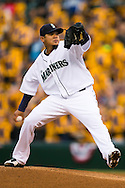 SEATTLE, WA - APRIL 11:  Felix Hernandez of the Seattle Mariners pitches during the game against the Texas Rangers on Thursday, April 11, 2013 at Safeco Field in Seattle, Washington.  Fans in attendance wear yellow King Felix T-Shirts in the background. (Photo by Ben VanHouten)