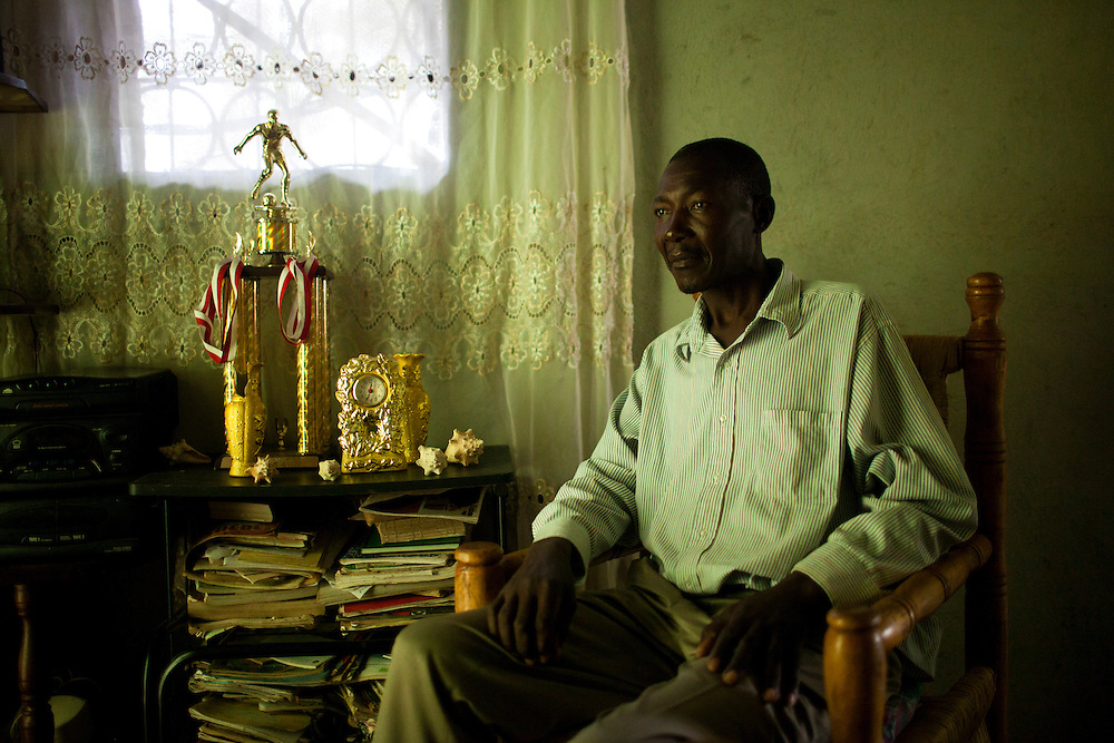 A man sits in his home on July 17, 2010 in Kenscoff, Haiti.