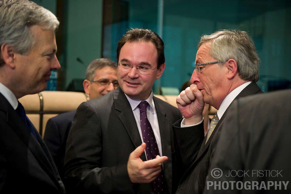 Jean-Claude Juncker, Luxembourg's prime minister, and president of the Eurogroup, right, speaks with George Papaconstantinou, Greece's finance minister, center, and Didier Reynders, Belgium's finance minister, left, during the meeting of European Union finance ministers in Brussels, Belgium, on Monday, May 17, 2010. (Photo © Jock Fistick)