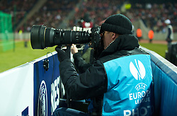 LILLE, FRANCE - Thursday, March 11, 2010: A photographer covering Liverpool and LOSC Lille Metropole during the UEFA Europa League Round of 16 1st Leg match at the Stadium Lille-Metropole. (Photo by David Rawcliffe/Propaganda)
