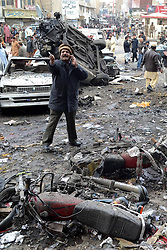 People gather at the blast site in Quetta, southwest Pakistan, Jan. 10, 2013. At least ten were killed and over 35 others injured when a bomb hit Quetta Thursday afternoon, reported local media Dunya, Quetta, southwest PakistanJanuary 10, 2013. Photo by Imago / i-Images...UK ONLY