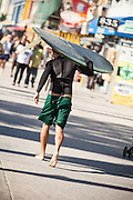 Surfer Walking Downtown Venice Beach California