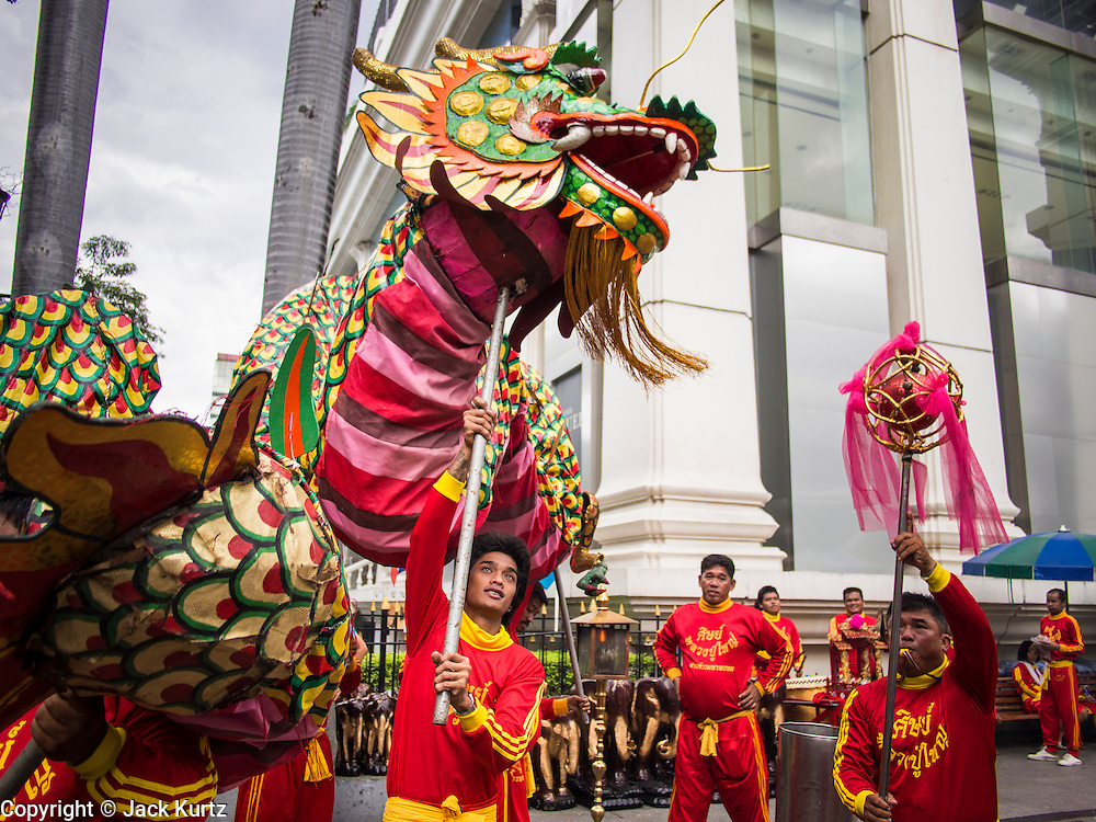 17 AUGUST 2013 - BANGKOK, THAILAND:    The Chinese Dragon Dance began during the Han Dynasty which lasted from 206 BC to 24 AD. In those ancient days it was performed by the people of China specifically to please their ancestors and to insure sufficient rain for a plentiful crop. In this way they hoped to protect against hunger and sickness. Over time the Dragon Dance became a central feature in Chinese celebrations with different colors symbolizing different characteristics or desired features; red for excitement, green for a good harvest, yellow for a solemn empire and gold or silver for prosperity. The Dragon Dance is a well-choreographed event whose difficulty is dependent upon the performers' skill. The length of the dragon indicates just how much luck it will bring in the coming year, but a longer dragon requires more performers with great skill as an error by one can ruin the entire performance. The dragon is typically between 82 and 229 feet long. The head along can weigh as much as 31 pounds. Both strength and skill are both required in performing the Chinese Dragon Dance.        PHOTO BY JACK KURTZ