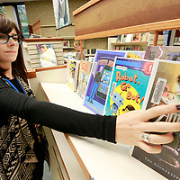 Thomas Wells | Buy at PHOTOS.DJOURNAL.COM<br /> Lee County Library employee Madeleine Pressley restocks the selves in the growing Manga/Comic Book section on Tuesday. The library has received a $7,500 grant to expand the section that has a growing demand.