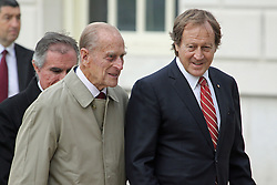 """© Licensed to London News Pictures. 18/10/2013. The Duke of Edinburgh and Bill Muirhead - agent general for South Australia. The world's oldest remaining clipper ship City of Adelaide is in Greenwich ahead of a renaming ceremony with the Duke of Edinburgh. She will then be moved to Australia despite attempts by heritage campaigners to keep her in the UK. Her new home in an Australian backwater has been controversial with one Australian MP saying this week she will be """"out of sight, out of mind"""". Her visit to Greenwich sees her briefly reunited with the famous clipper Cutty Sark, loosely described as a """"sister ship"""". Credit : Rob Powell/LNP"""