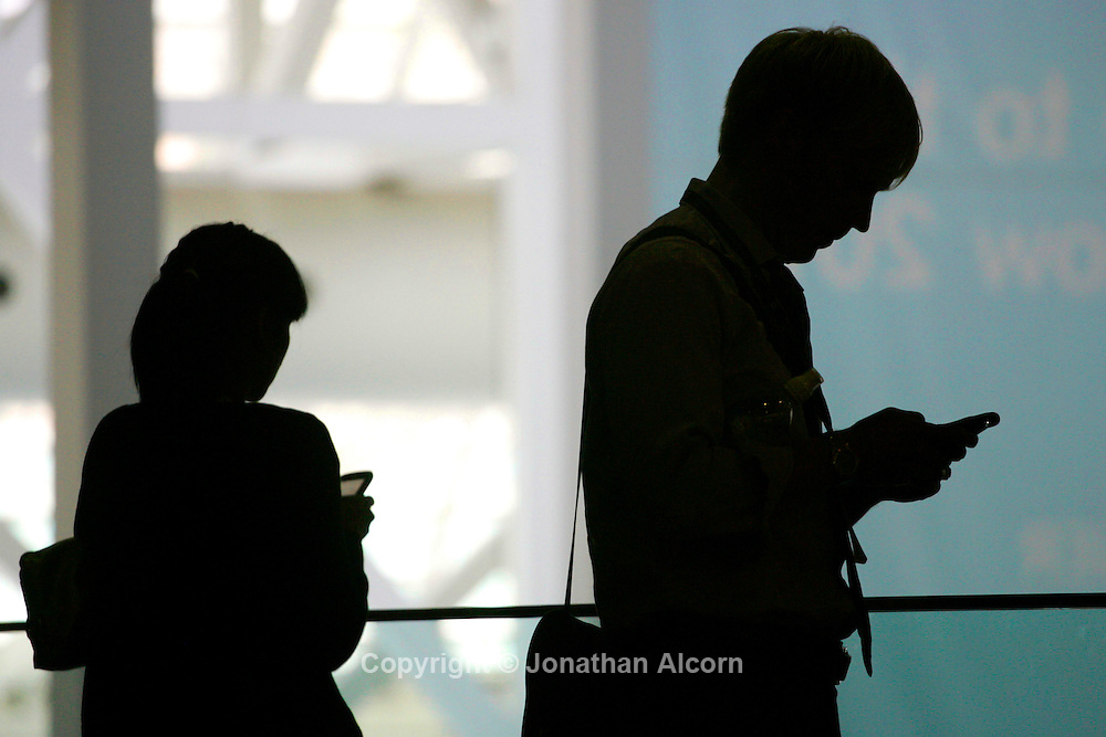May 12, 2010 - Los Angeles, California, U.S - Mobile phone device users type smart phone text messages at a business convention