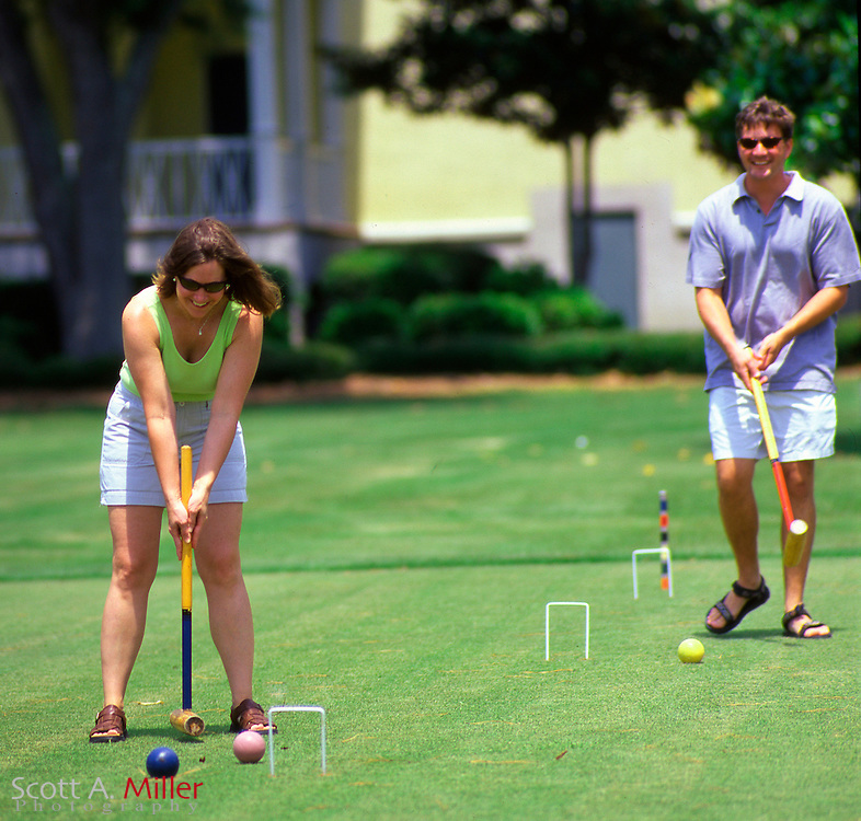 A couple plays Croquet at Dafuskie Island resort in South Carolina...©2003 Scott A. Miller