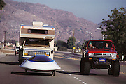 Sunraycer is being followed by its support vehicle during a road test in the California Mojave desert USA. Sunraycer, General Motors' entry for the Pentax World Solar Challenge, the first international solar-powered car race, which began in Darwin, Northern Territories on November 1st, 1987 and finished in Adelaide, South Australia. Sunraycer was the eventual winner, taking 5 1/2 days to complete the 1,950 miles, traveling at an average speed of 41.6 miles per hour. Strict rules were applied throughout the race. Entrants were permitted two 2-hour solar battery charging sessions per day, performed immediately before & after each daily stage. (1987).