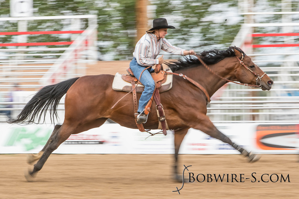 Janet Baughman makes her barrel racing run during slack at the Elizabeth Stampede on Sunday, June 3, 2018.
