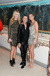 Left to right, MELISSA ODABASH, JULIEN MACDONALD and ABBEY CLANCY at Fashion For The Brave at The Dorchester, Park Lane, London on 8th November 2013.