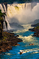 Speedboats on the Iguazu River below Iguazu Falls (Iguacu in Portugese), on the border of Brazil and Argentina. It is one of the New 7 Wonders of Nature and is a UNESCO World Heritage Site. There are 275 waterfalls total which make up the largest waterfalls in the world.