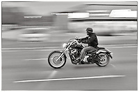 Man on a motorbike with spiked helmet, Chicago, Illinois, USA.