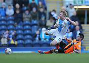 Emmanuel Ledesma, Brighton midfielder and Chris Taylor, Blackburn Rovers midfielder during the Sky Bet Championship match between Blackburn Rovers and Brighton and Hove Albion at Ewood Park, Blackburn, England on 21 March 2015.