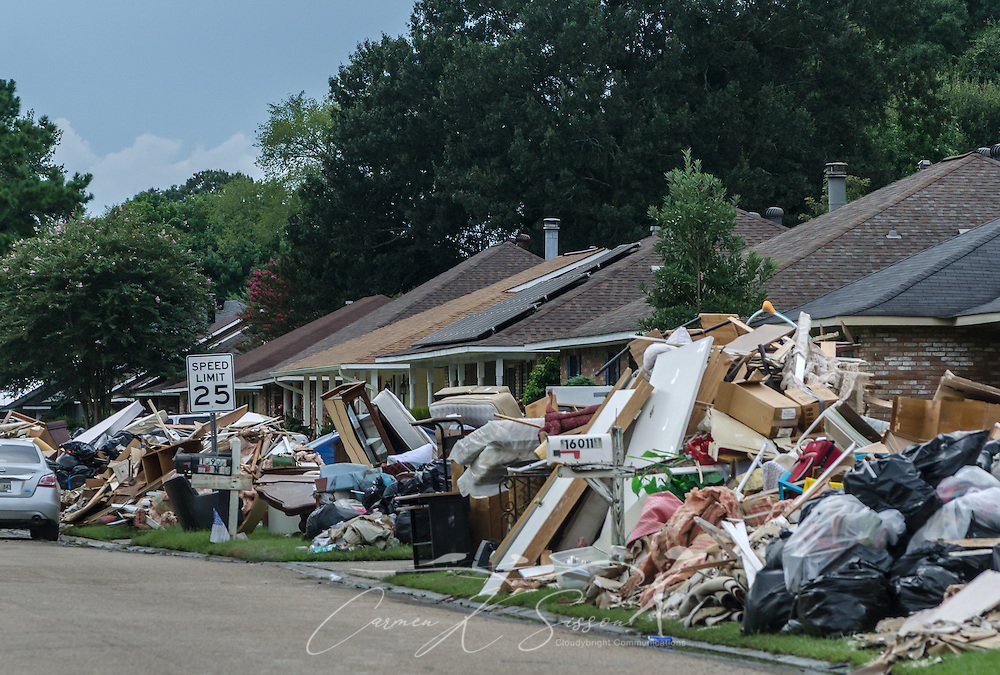 Unsalvageable household items line the curbs of Woodwick Avenue, Aug. 21, 2016, in Baton Rouge, Louisiana. Approximately 20 parishes in Louisiana experienced severe flooding after receiving torrential rain Aug. 12-15, 2016, and 13 people died. Southern Baptist Disaster Relief, along with numerous other agencies, responded quickly to help with mud out, feeding, and other survivor needs. (Photo by Carmen K. Sisson/Cloudybright)