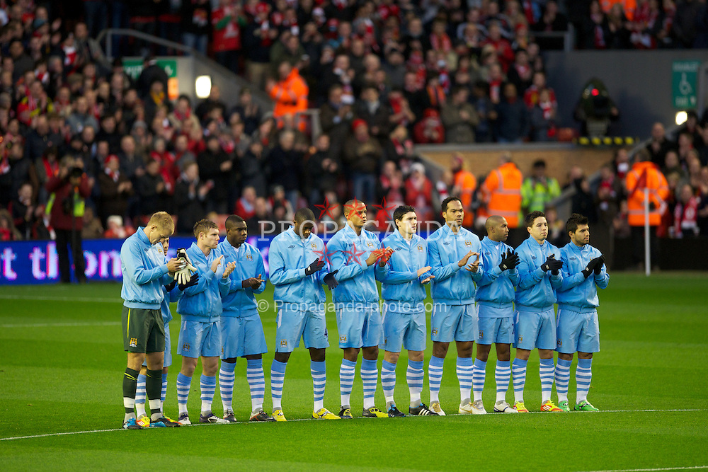 LIVERPOOL, ENGLAND - Sunday, November 27, 2011: Manchester City players stand still for one minute in memory of Liverpool's goalkeeper Brad Jones' son, Luca, and Wales manager Gary Speed, who died this morning, before the Premiership match at Anfield. (Pic by David Rawcliffe/Propaganda)