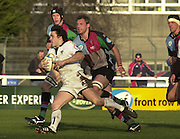 Parker Pen Challenge Cup 14/01/2004 Harlequins v Brive.1st leg...Brive's Jerome Nave, running round Luke Sherriff and Jim Evans [cap]   [Mandatory Credit, Peter Spurier/ Intersport Images].