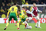 Norwich City midfielder Tom Trybull (19) challenged by the opponent during the The FA Cup match between Burnley and Norwich City at Turf Moor, Burnley, England on 25 January 2020.