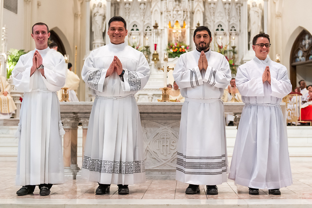 DENVER, CO - MARCH 2: Christopher James Considine, Juan Adrian Hernandez, Juan Manuel Madrid and Christian James Mast stand before the congregations during the transitional deacon ordination at the Cathedral Basilica of the Immaculate Conception on March 2, 2019, in Denver, Colorado. (Photo by Daniel Petty/for Denver Catholic)