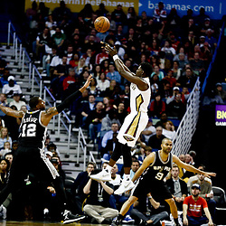 Mar 3, 2017; New Orleans, LA, USA; New Orleans Pelicans guard Jrue Holiday (11) shoots over San Antonio Spurs forward LaMarcus Aldridge (12) during the second half of a game at the Smoothie King Center. The Spurs defeated the Pelicans 101-98 in overtime. Mandatory Credit: Derick E. Hingle-USA TODAY Sports
