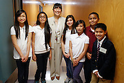 Principal Kathy Doi poses for a portrait with the Zanker student body during the KLA-Tencor Computer Lab opening ceremony at Zanker Elementary School in Milpitas, California, on February 27, 2013. (Stan Olszewski/SOSKIphoto)