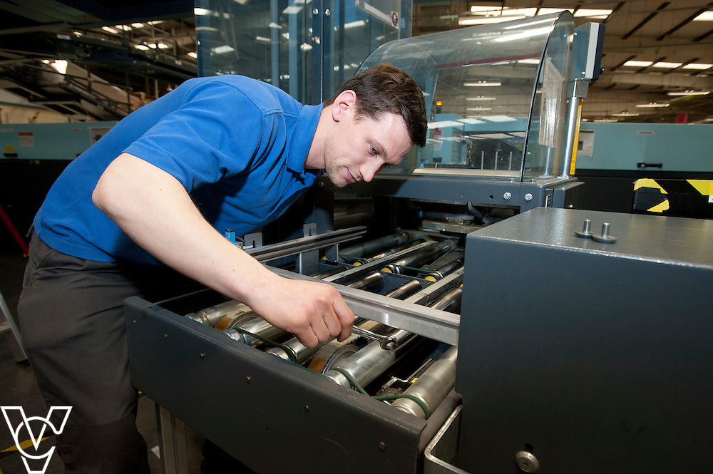 Royal Mail - Preston Mail Centre: <br /> <br /> Pictured is Michael Wild carrying out some preventative maintenance on a machine <br /> <br /> Date: March 16, 2015