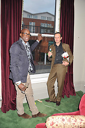 Left to right, CHARLES ABOAH and TOM DIXON holding his dog Molly at a dinner hosted by Bella Freud for German artist Marcel Odenbach at her home 275 Kensal Road, London W10 on 6th June 2011.