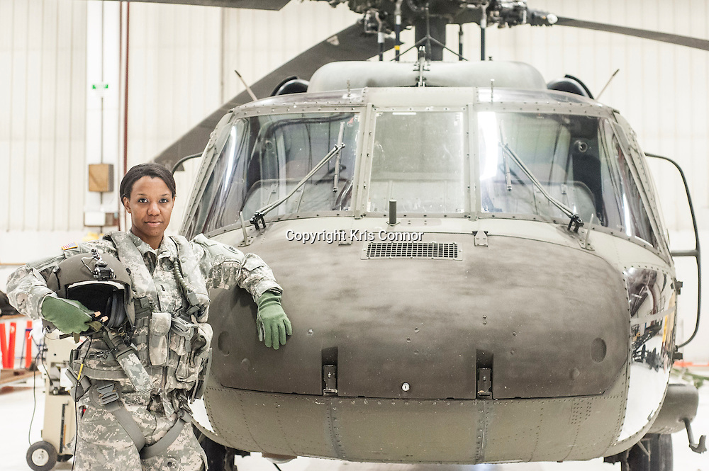 First Lieutenant Dina Elosiebo of Memphis, TN poses with a Washington DC National Guard UH-60 BlackHawk at Davison Army Airfield in Fort Belvoir, Va on April 15th, 2014. Elosiebo is the first female black helicopter pilot in the Washington DC National Guard. Photo by Kris Connor<br />