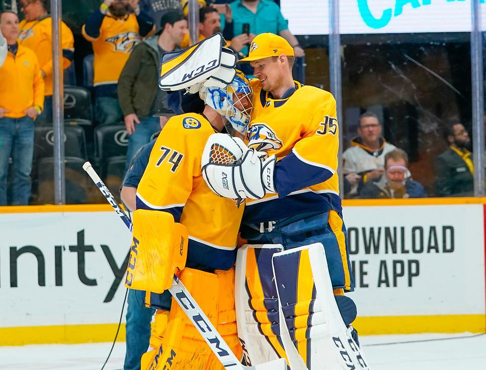 Nashville Predators goaltender Pekka Rinne (35) congratulates Nashville Predators goaltender Juuse Saros (74) on his shutout during an NHL game between the Dallas Stars and Nashville Predators at Bridgestone Arena in Nashville, TN