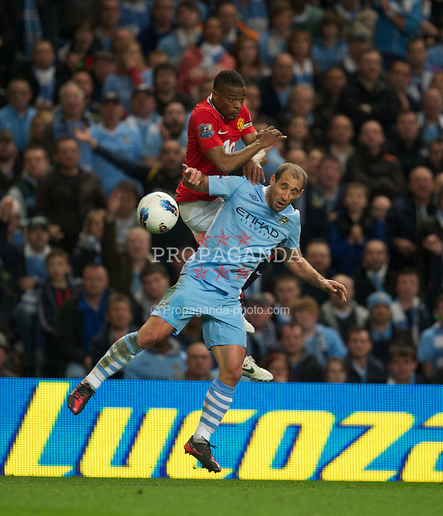 MANCHESTER, ENGLAND - Monday, April 30, 2012: Manchester City's Pablo Zabaleta in action against Manchester United's Patrice Evra during the Premiership match at the City of Manchester Stadium. (Pic by David Rawcliffe/Propaganda)